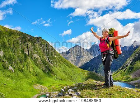 Happy hiker on top of hill in Siberian mountains. East Sayan. Russia