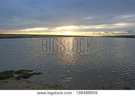 Fleet basin and Chesil bank at sunset