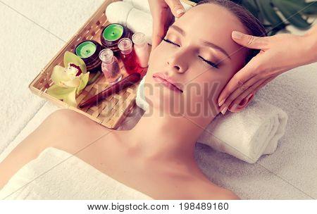 Massage and body  care. Spa body massage treatment. Woman having massage in the spa salon for beautiful girl . Headache relief
