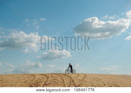 Bicyclist In Desert. Extreme Sport.