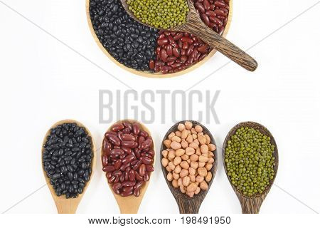 Seeds beans(Black Bean, Red Bean, Peanut and Mung Bean) useful for health in wood spoons on white background.