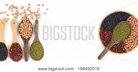 Seeds beans(Black Bean, Red Bean, Peanut and Mung Bean) useful for health in wood spoons on white background for banner.
