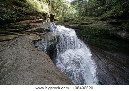 Waterfall over rocky terrain in the jungle of Colombia