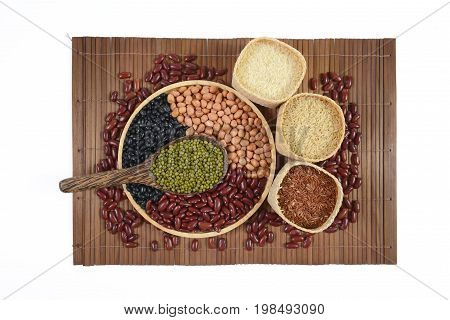Cereal grains and Seeds beans(Black Bean, Red Bean, Peanut, Mung Bean, Thai Jasmine Rice, Brown Rice and White Rice) useful for health in wood spoons on white background.