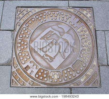 Nykøbing. June-14-2017. Manhole cower in the city of Nykøbing on the island Falster. Denmark