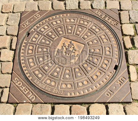 Nykøbing. June-14-2017. Manhole cower in the city of Nykøbing on the island of Falster. Denmark