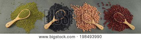 Seeds beans(Black Bean Red Bean Peanut and Mung Bean) useful for health in wood spoons on grey background.