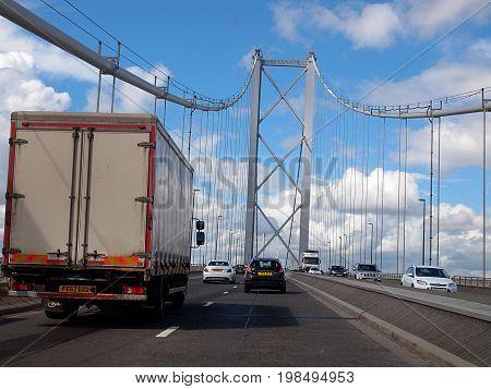 On the bridge in Edinburgh. Edinburgh, Scotland - July 27, 2017 Movement of cars on the road bridge in Edinburgh.