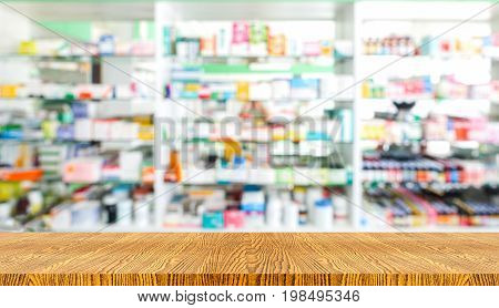 wooden tabletop with blurred of medicine background use for drugs or products display