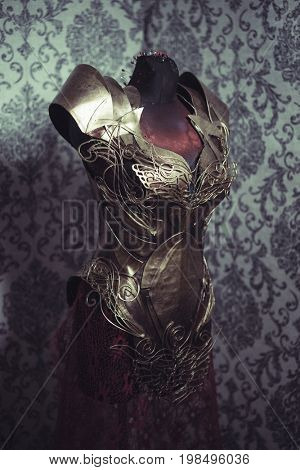 Armor of woman Strong metal breastplate handmade in gold with gothic shapes and fine steel strands