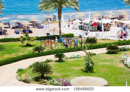Sharm El Sheikh, Egypt - April 8, 2017: The view of luxury hotel Barcelo Tiran Sharm 5 stars at day with blue sky at Sharm El Sheikh, Egypt on April 8, 2017 with Animation team and darts game
