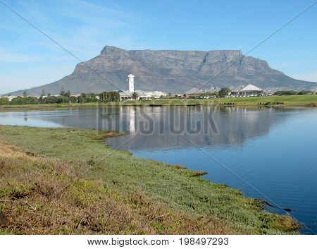 FROM CAPE TOWN, SOUTH AFRICA, VIEW OF TABLE MOUNTAIN REFLECTING ON THE MILNERTON LAGOON