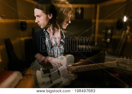 Guitarist in double exposure. Split personality. Musical recording studio, dark heavy music, psychological condition with drugs