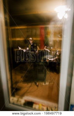 Creative musical recording studio in garage. Split personality, music background, band rehearsal before concert, blurred motion