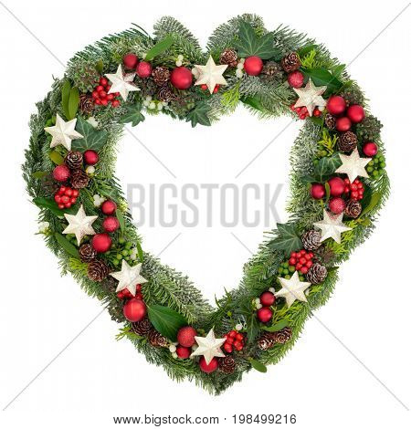 Heart shaped christmas wreath with star and bauble decorations, holly, mistletoe, ivy, pine cones, snow covered blue spruce and juniper fir on white background.