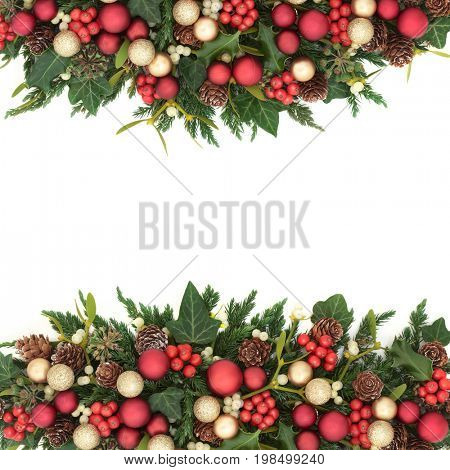 Christmas background border with gold and red bauble decorations, holly, ivy, mistletoe, fir and pine cones on white.