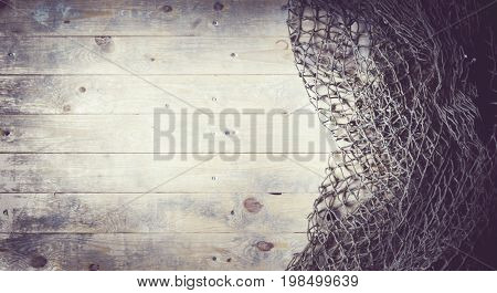 Fishing nets on wooden background. Still-life and objects.