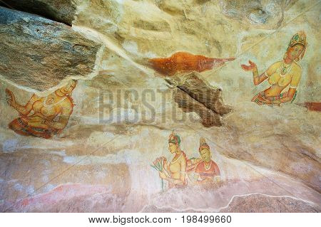 SIGIRIYA, SRI LANKA - MAY 20, 2011: Exterior of the ancient paintings at Sigiriya rock in Sigiriya, Sri Lanka. Sigiriya is a UNESCO World Heritage Site.