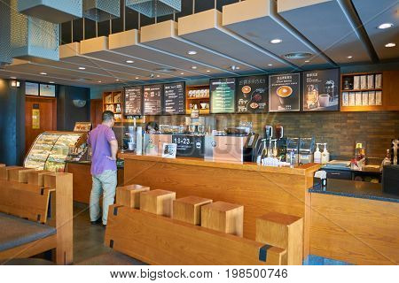 SHENZHEN, CHINA - CIRCA OCTOBER, 2015: inside Starbucks coffee shop in Shenzhen. Starbucks Corporation is an American coffee company and coffeehouse chain.