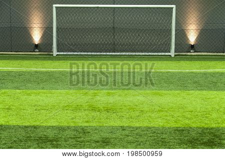 Green Grass Soccer Or Football Field And Goal Post Background