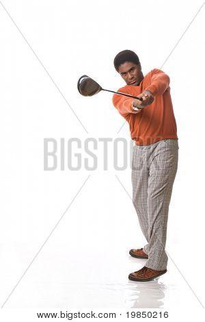 Handsome African-American man swings a golf club