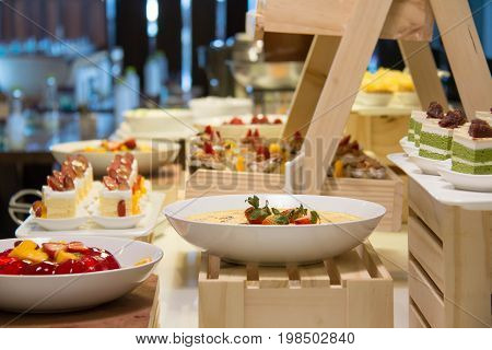 A Assorted different mini cakes on buffet