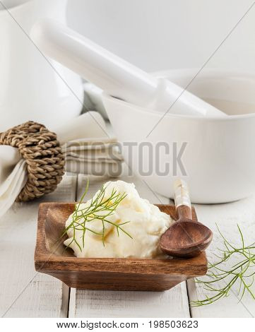 Horseradish cream sauce with dill on a white wooden table
