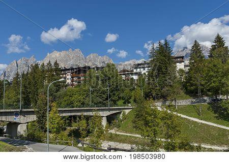 Autumnal corso Italia, the beautiful stone bridge in Cortina D'Ampezzo near Dolomite mountains,  Dolomite, Alps, Veneto, Italy, Europe