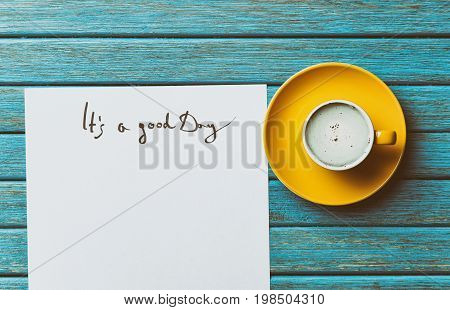 Paper And Cup Lying On The Table