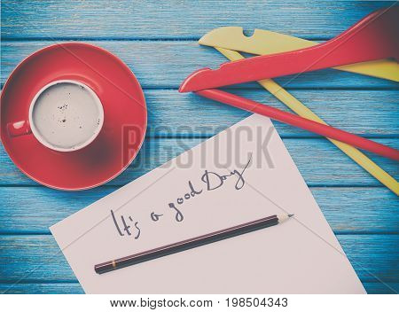 Paper, Cup And Hangers Lying On The Table