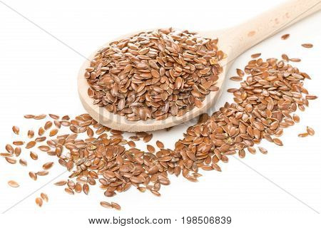 Raw unprocessed linseed or flax seed in wooden spoon over white background