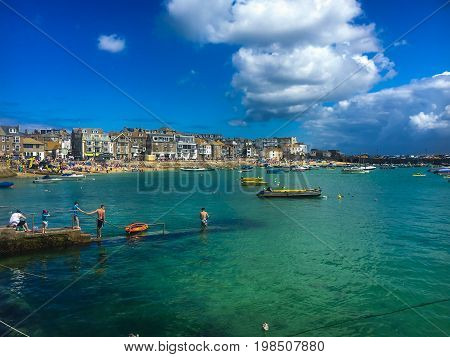 ST. IVES - UNITED KINGDOM - KULY 9, 2017: Popular St Ives Atlantic ocean coast Cornwall England United Kingdom