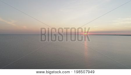 Aerial shot over baltic sea in sunset time, wide photo