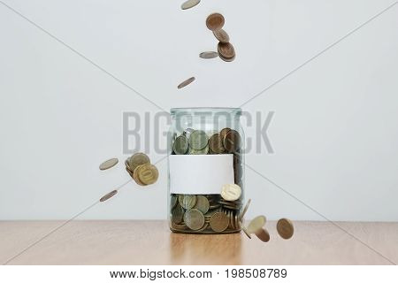 Glass Jar Full Of Falling Coins, Blank Sticker, Money Box. Cash Or Penny Saving
