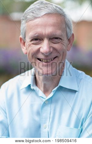 Outdoor Head And Shoulders Portrait Of Mature Man