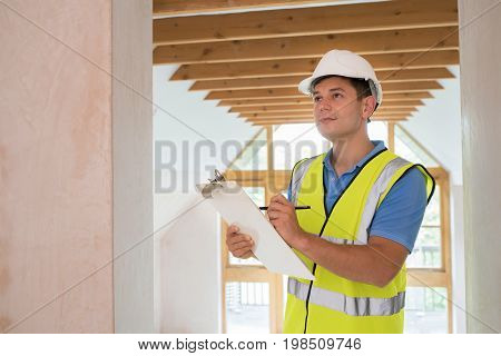 Building Inspector Looking At Interior Of New Property poster