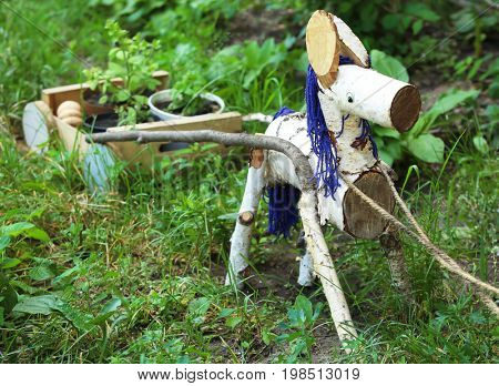 Wooden donkey with cart as garden decor outdoors