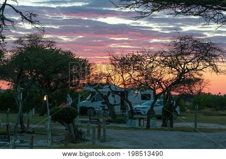 ETOSHA NATIONAL PARK NAMIBIA - JUNE 21 2017: Dawn at the caravan park in Namutoni Rest Camp in the Etosha National Park of Namibia