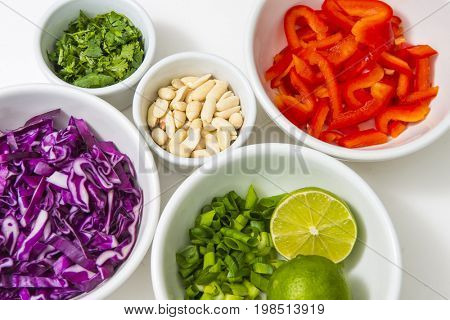 Healthy colorful food chopped produce vegetables recipe ingredients prepared and ready in white bowls background diet lifestyle