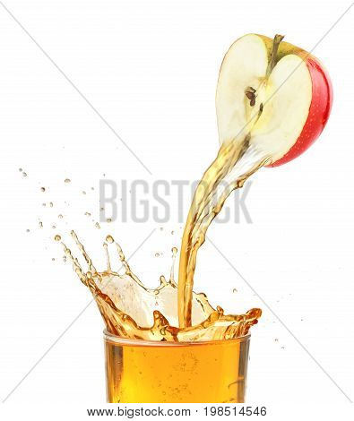 Fresh apple juice flowing from apple piece into the glass. Isolated on a white background.