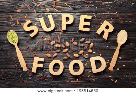 Text made of letters and superfoods on wooden background
