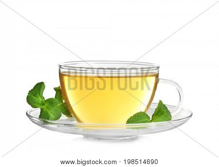 Cup of hot aromatic tea with lemon balm on white background