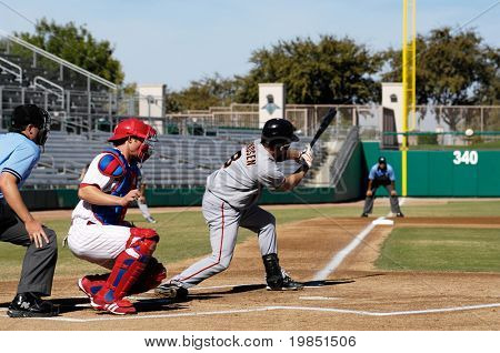 MESA, AZ - NOV 20: Kevin Frandsen of  the Scottsdale Scorpions hits with Mesa Solar Sox catcher Lou Marson behind the plate, in the Arizona Fall League game on November 20, 2008 in Mesa, Arizona