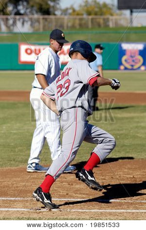 MESA, AZ - NOV 20: Josh Reddick of  the Scottsdale Scorpions rounds first  in the Arizona Fall League game with the Mesa Solar Sox on November 20, 2008 in Mesa, Arizona.