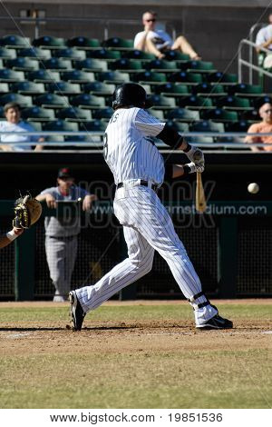 MESA, AZ - NOV 20: Scott Cousins of the Mesa Solar Sox swings at a pitch in an Arizona Fall League baseball game with the Scottsdale Scorpions on November 20, 2008 in Mesa, Arizona.