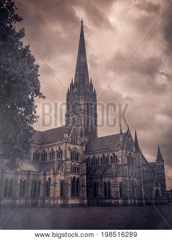 Salisbury cathedral in the fog, mystique atmosphere