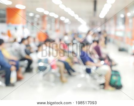 Blurred People are Sitting in the waiting hall , To wait for service use us waiting time management in service operations background.