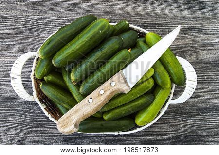 Fresh cucumber pictures on a white background, natural and organic cucumbers, cucumber pictures cut with a knife in a basket