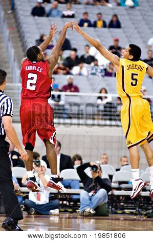 GLENDALE, AZ - DECEMBER 20: Preston Knowles #2 of the Louisville Cardinals shoots over Devoe Joseph #5 of the Minnesota Gophers in the basketball game on December 20, 2008 in Glendale, Arizona.