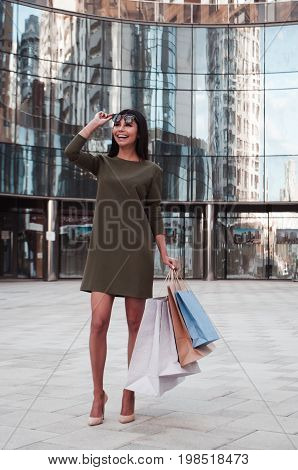 Portrait of a happy young woman on a shopping spree in the city